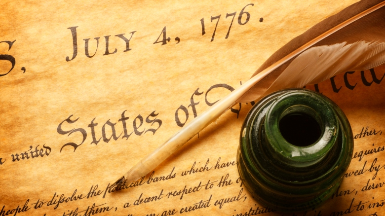 Quill and inkwell on top of Declaration of Independence